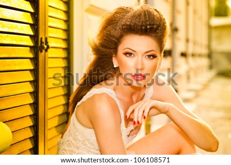 very beautiful model wearing gold make-up