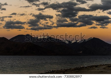 very beautiful nature of Himalaya mountains background from pangong lake leh lardakh,india in twilight sky #730882897