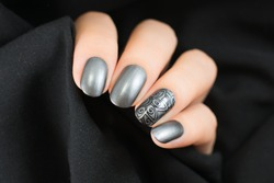 Very beautiful silver metallic nails closeup.