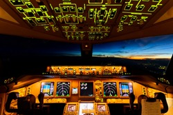 Very beautiful sky view from airplane inside cockpit when airplane fly over the ocean in evening twilight. Seen from the back seat when airplane is cruising at high altitude. Modern aviation concept.