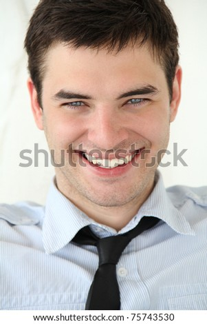 Very beautiful smile on the face. Portrait of handsome young men with blue eyes and white teeth
