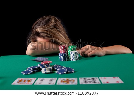 Very beautiful woman playing texas hold'em poker