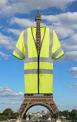 Very Big jacket symbol of Yellow vests movement on Eiffel Tower in Paris France.