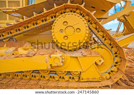 very close up view on the track of bbulldozer on sand #247145860