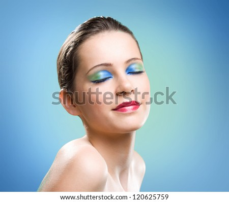 Very colorful cosmetic makeup portrait of young beauty.
