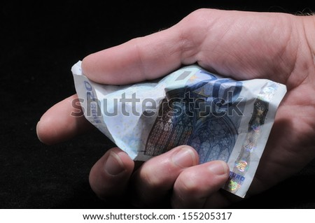 Very Crumpled Banknotes Money over a Black Background