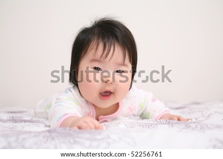 Very Cute Asian Baby Infant Girl Reaching and Smiling