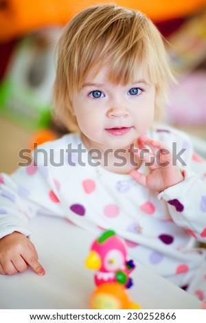 Very cute blue-eyed blonde girl in pajamas