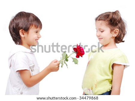 Very cute scene of two little children with rose