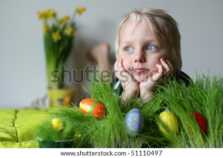Very cute 5 years old boy. Narcissus on background