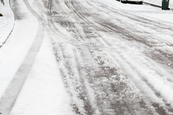 Very dangerous freezing rain over snow covered roads during a winter ice storm in Eugene Oregon.