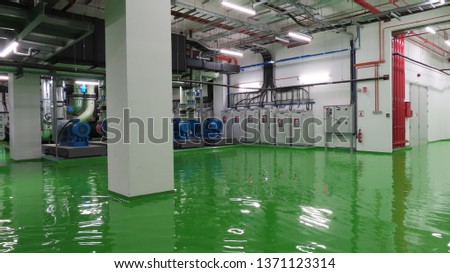 Very dangerous situation. Industry Chiller and compressor plant in a flood of water during a large supply pipe leak.  stock photo