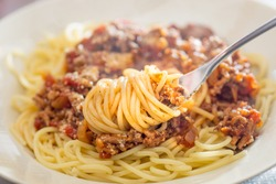 Very delicious Italian meat sauce on white background