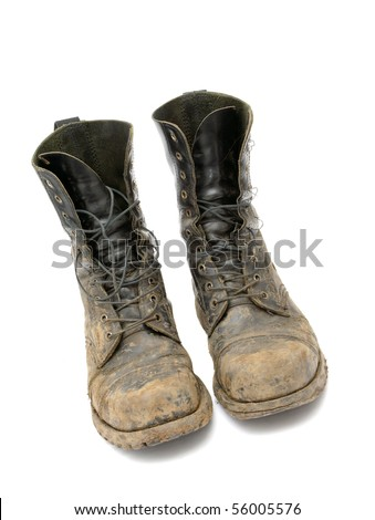 Very dirty boots isolated on white background