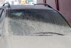 Very dirty car abandoned on German street in Hamburg under a bridge. Full frame horizontal orientation