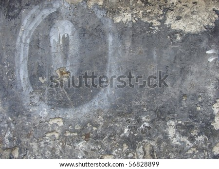 very dirty gray wall with graffiti sprayed circular element