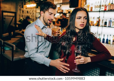 Very drunk man want to meet with beautiful girl. She refuses to meet with a guy who drank too much alcohol. She doesn;t like him at all. #1059949883