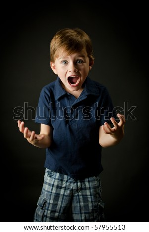 Very emotional young boy screaming with all his energy #57955513