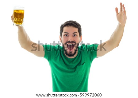 Very enthusiastic for the celebration of St Patrick's. Young man wearing green clothes on white background, related to Saint Patrick's day. Photo stock ©
