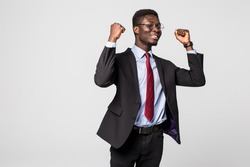 Very excited African business man with his arms in the air isolated grey