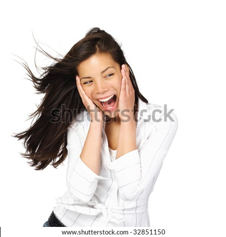 Very excited mixed caucasian / asian woman holding her head in amazement. Isolated on white.