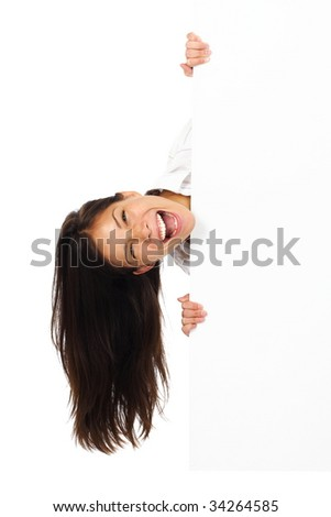Very excited woman holding billboard / blank sign. Isolated on white.