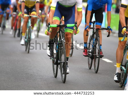 very fast cyclists pedal quickly through the streets of the city during the sporting event in europe #444732253