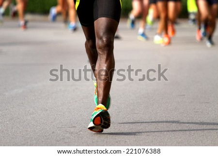 very fast runner with sneakers during the Marathon on road #221076388