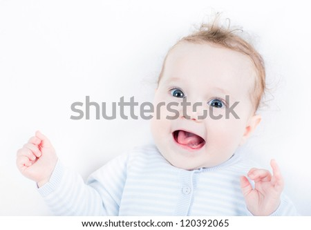 Very funny baby girl showing her tongue