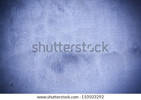 Very grungy plaster blue wall background
