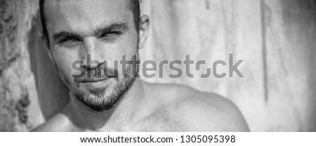 Very Handsome Caucasian Male Model Posing on Beach Wall (Black and White) #1305095398
