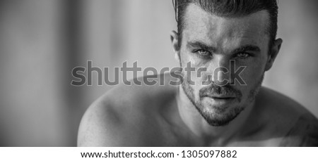 Very Handsome Caucasian Male Model Posing on Beach Wall (Black and White) #1305097882