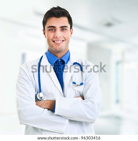 Very handsome young doctor with blue eyes portrait