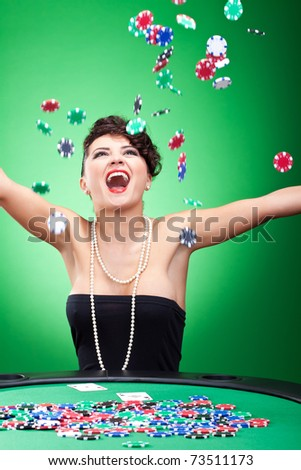 very happy casion lady winning and throwing chips in the air
