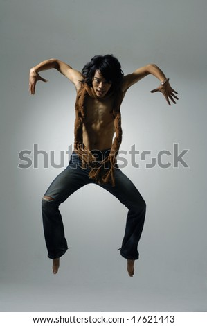 Very happy casual man jumping