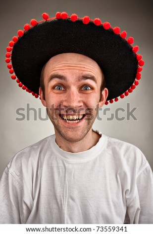 Very happy stupid laughing man in sombrero hat