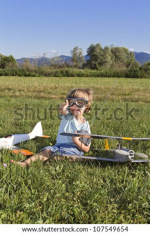 Very happy young boy and his RC plane, outdoors