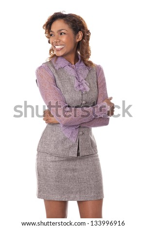 Very happy young business woman flashes a perfect smile while looking to the side.