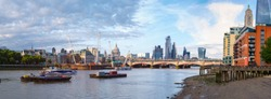 Very high resolution panoramic image of London at sunset with the river Thames, St Paul Cathedral, Blackfriars Bridge and the City - All logos and trademarks removed