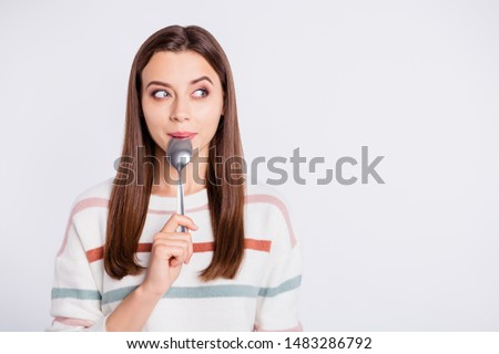 Very hungry lady holding spoon into mouth dream of tasty meal wear striped pullover isolated white background