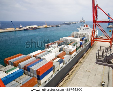 very large container-ship in the port during cargo operation