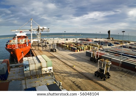 very large container-ship in the port during cargo operation - stock photo