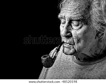 Very Nice Image of an Old man and His Pipe - stock photo
