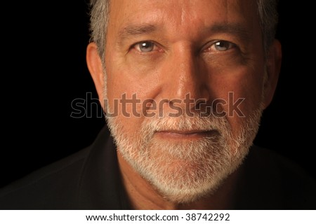 Very Nice Portrait of a serious Latino Man On Black