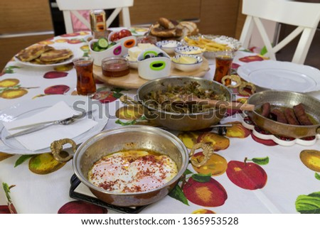 very nicely prepared breakfast table for special, valentines' day or Ramadan or Christmas in the room. Pasta, omelette ,salads, cheese on the table for party time.