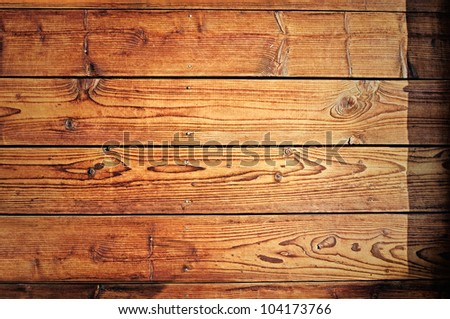Very old and worn wooden planks with rusty nails.