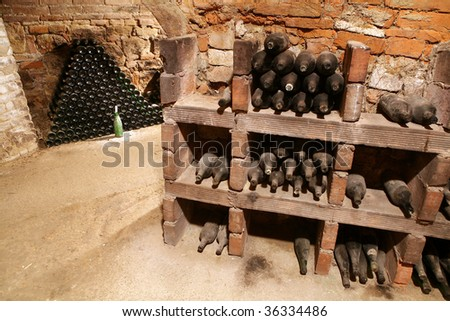 very old bottles in wine cellar