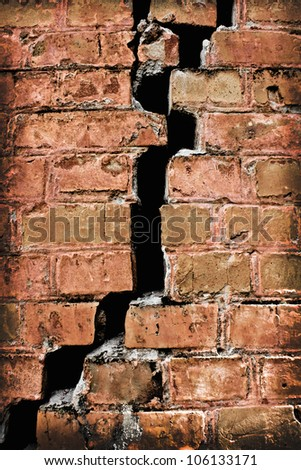 very old brick wall with a crack