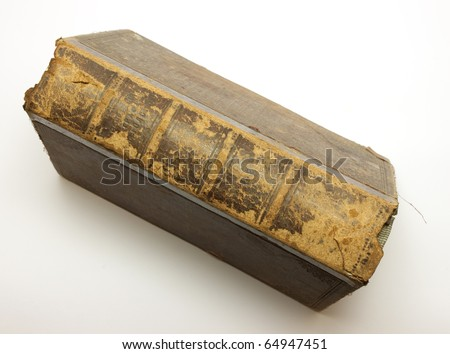Very old brown book over white background