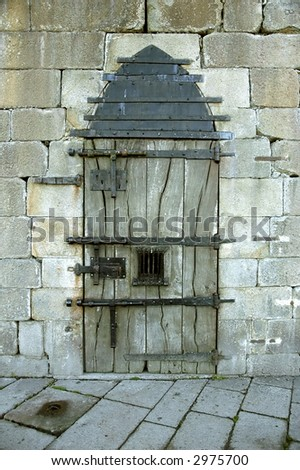 Very old castle door with rusty details